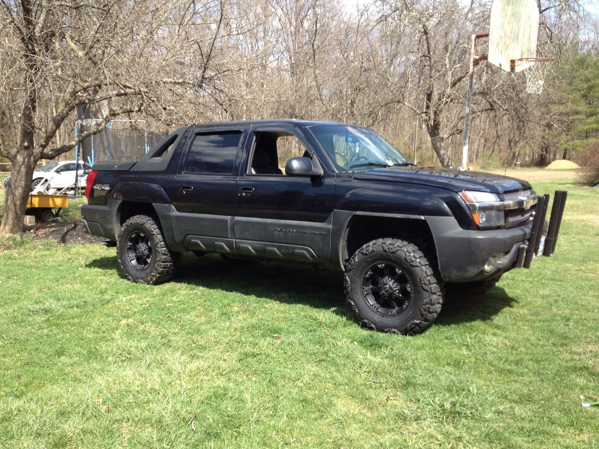 2002 chevy avalanche 2500 with 35 nitto mud grapplers on 17 ballistic rims